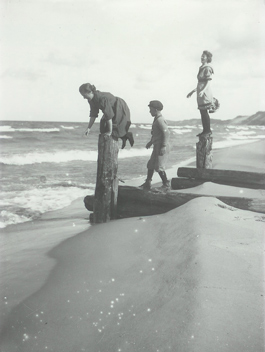historical photo of kids playing on Lake Michigan beach